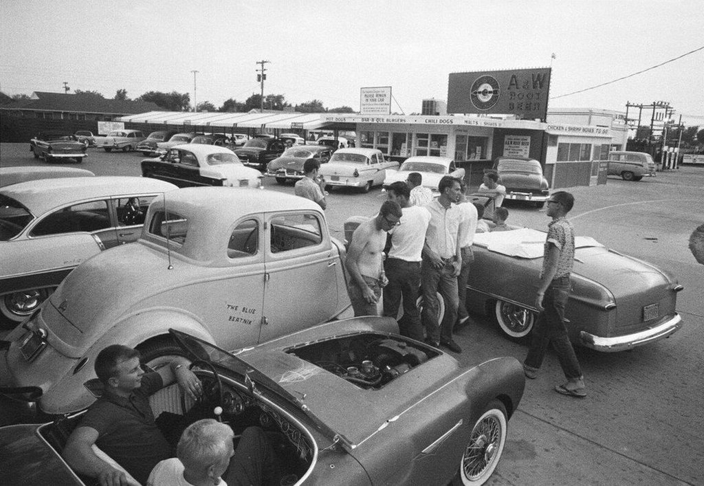 1959_teenagers_in_the_parking_lot_of_an_a_w_drive-in_hutchinson_kansas.jpg