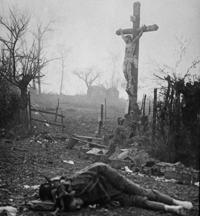 1916_korul_devastation_and_bodies_of_dead_soldiers_a_crucifix_stands_tall_miraculously_preserved_from_the_shell_fire_the_powerful_image_was_captured_after_a_bloody_skirmish_during_the_battle_of_the_somme.jpg
