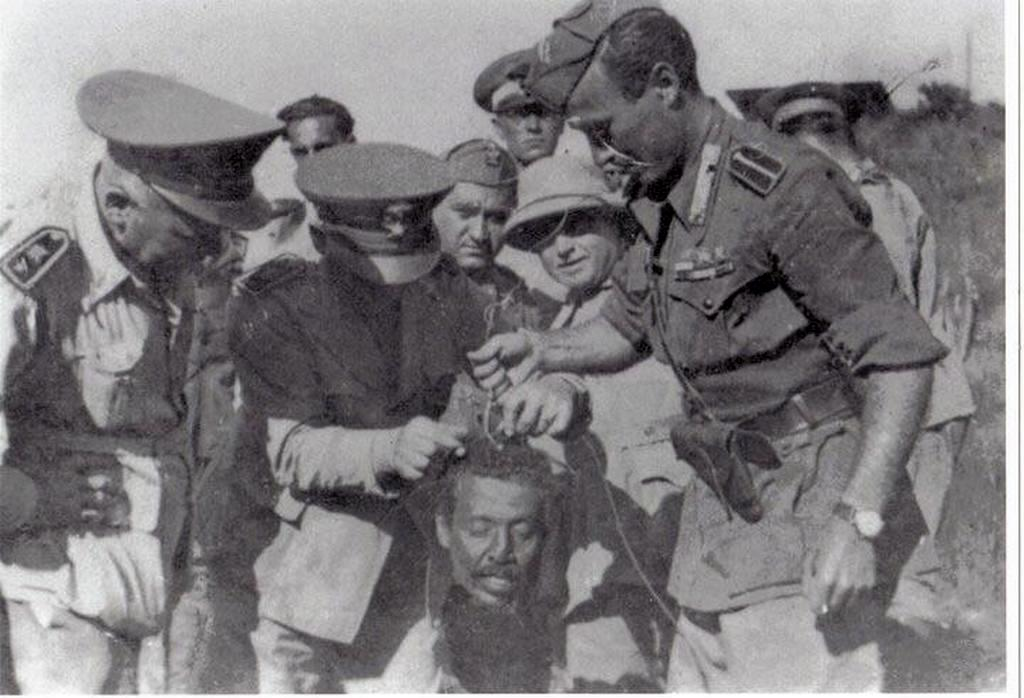 1937_fascist_italians_holding_the_head_of_ethiopia_first_general_hailu_kebede_before_they_sent_it_to_rome_for_mussolini_to_see_it.jpg