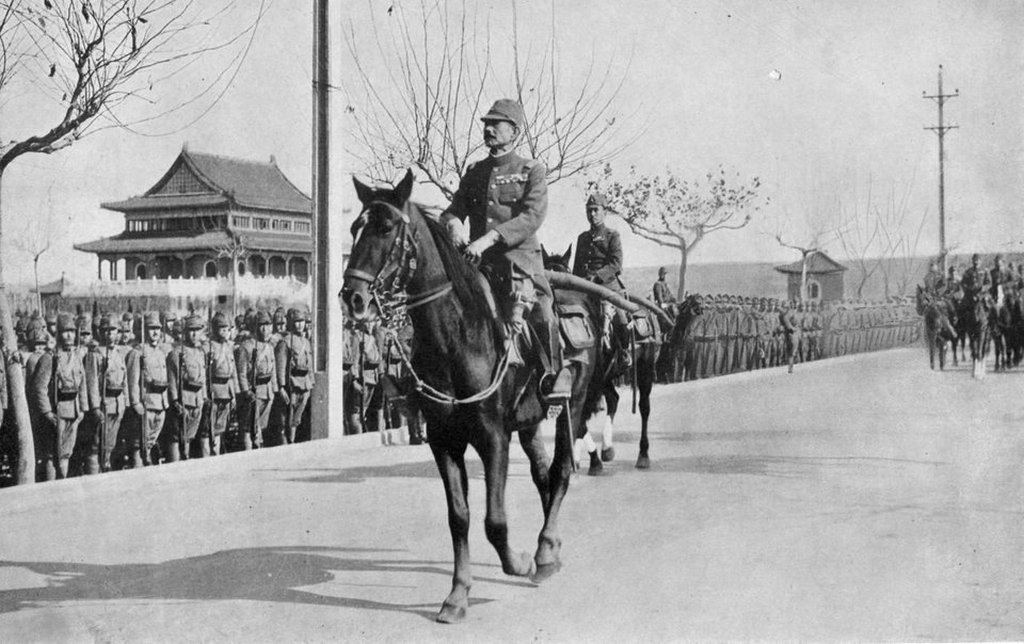 1937_dec_17_battle_of_nanjing_japanese_general_iwane_matsui_marching_into_nanjing_china.jpg