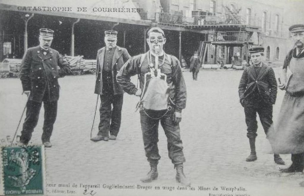 1906_rescue_service_member_with_breathing_equipment_stands_by_during_the_courrieres_mine_disaster_which_caused_the_death_of_1_099_miners_in_northern_france.jpg