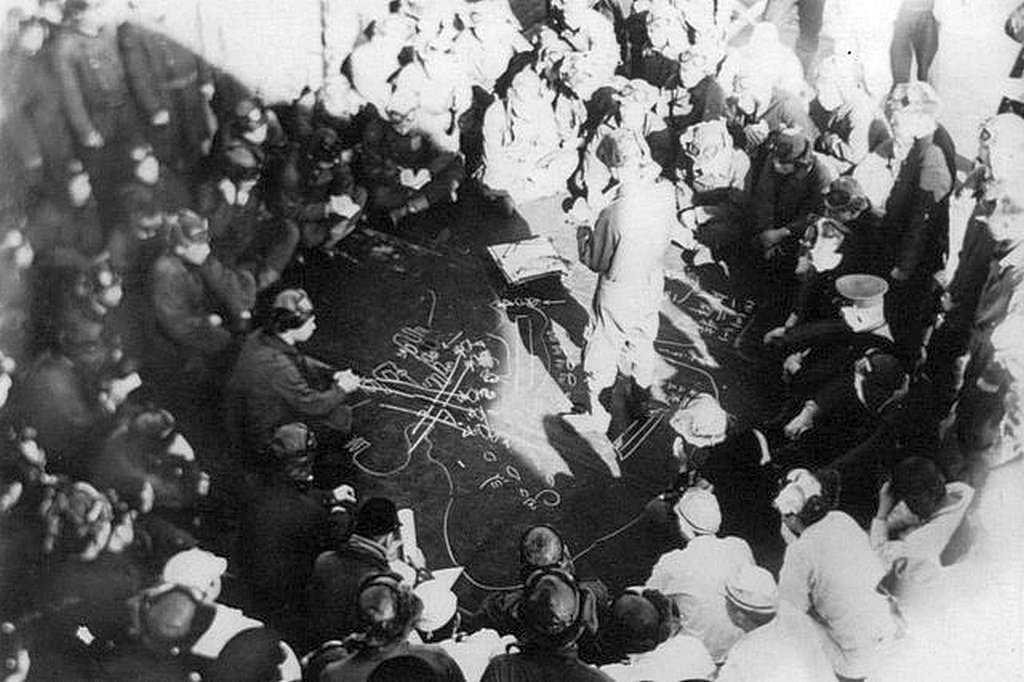 1941_december_6_japanese_navy_lieutenant_ichiro_kitajima_briefs_his_nakajima_b5n2_kate_crews_aboard_the_aircraft_carrier_kaga_about_the_plan_for_the_attack_on_pearl_harbor.jpg
