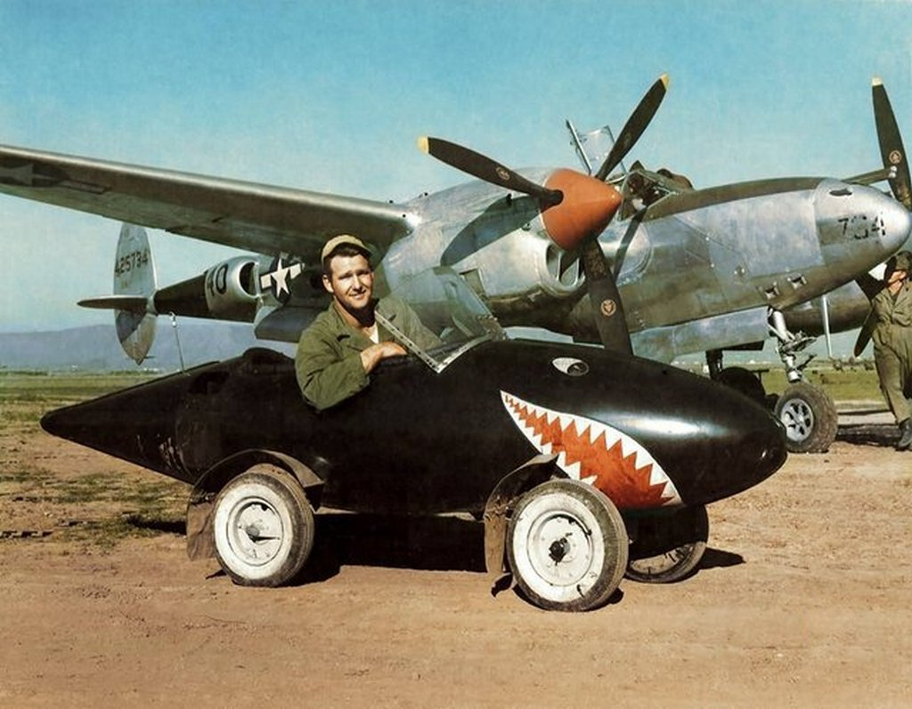 1944_a_ground_crewman_from_the_usaaf_1st_fighter_group_poses_with_his_makeshift_car_built_from_a_p-38_s_315_gallon_external_fuel_tank_italy_possibly_salsola_airfield.jpg