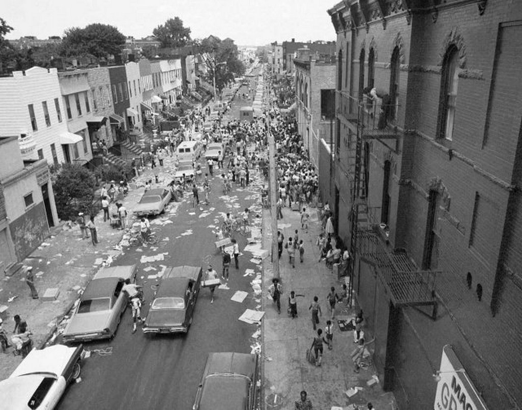 1977_a_street_in_the_bedford-stuyvesant_section_of_brooklyn_is_full_of_people_and_debris_july_14_1977_following_last_night_s_massive_blackout_in_new_york_city.jpg