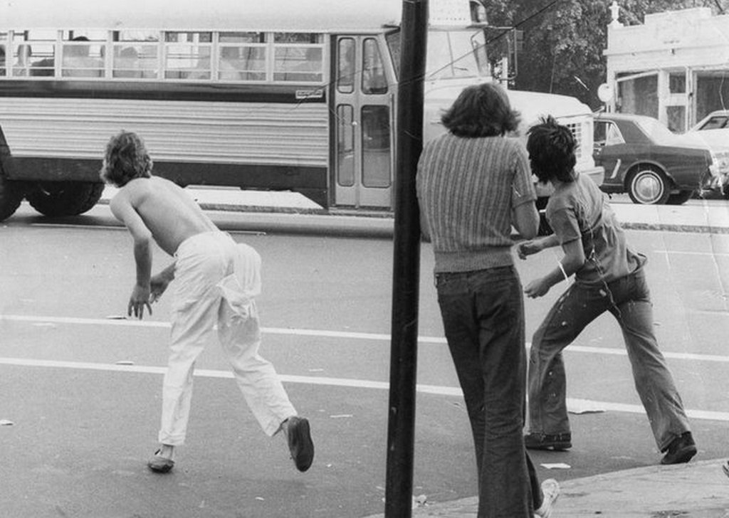 1974_white_kids_in_dorchester_boston_threw_objects_at_a_school_bus_carrying_black_students_on_their_way_to_south_boston_high_school_during_the_boston_busing_crisis.jpg