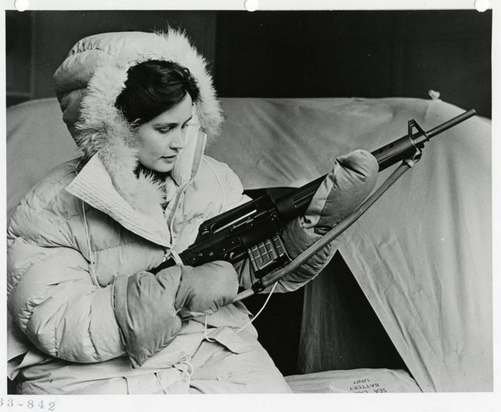 1959_klm_flight_attendant_displays_her_ar-10_rifle_and_parka_two_parts_of_polar_survival_gear_issued_to_commercial_aircrews_flew_over_the_north_pole_the_rifle_was_intended_to_defend_against_bear.jpg