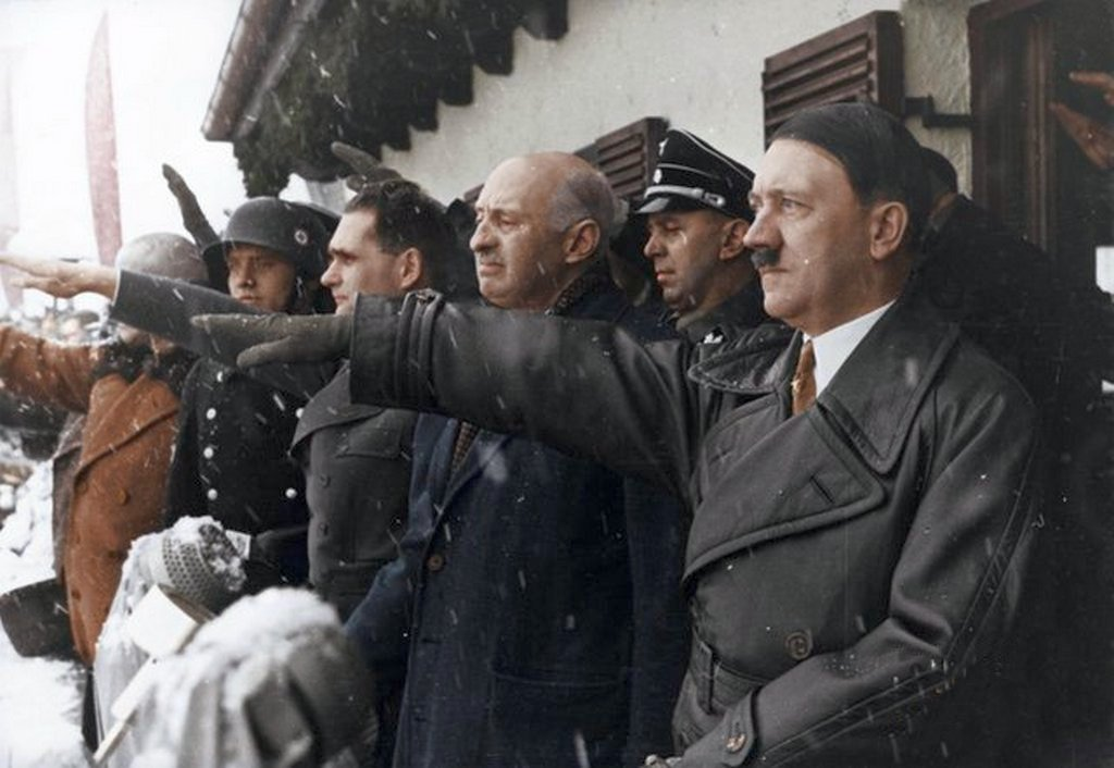 1936_februar_6_chancellor_hitler_saluting_the_athletes_from_balcony_of_the_olympic_house_during_opening_ceremony_of_the_iv_olympic_winter_games_garmisch-partenkirchen_bavaria_germany.jpg