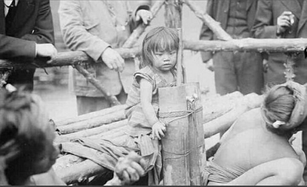1914_girl_from_philippines_she_was_displayed_at_the_coney_island_zoo_she_was_a_zoo_attraction_among_the_monkeys_and_lizards_she_was_bound_by_ropes_visitors_threw_her_peanuts.jpg