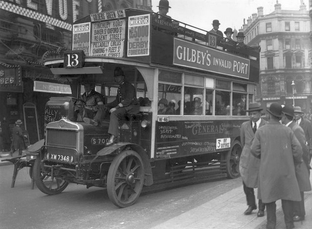 1926_majus_an_lgoc_bus_being_driven_in_london_by_a_volunteer_driver_with_a_police_escort_during_the_general_strike.jpg