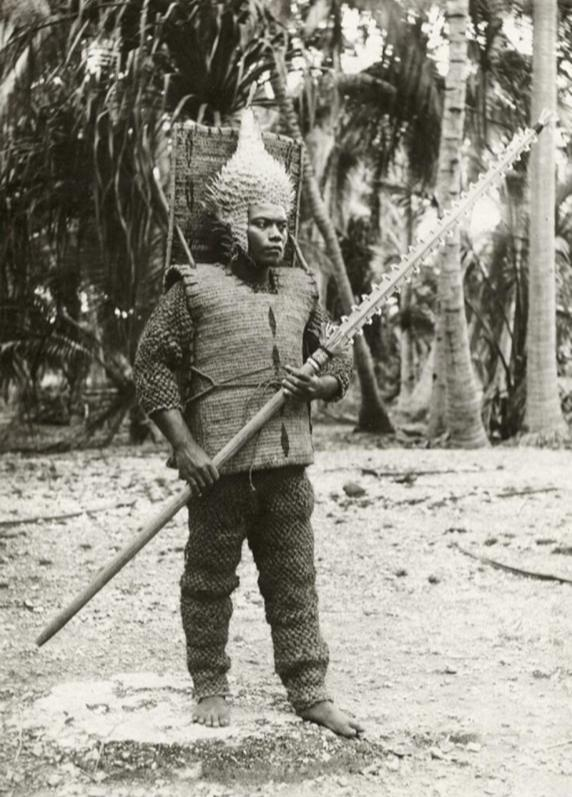 1905_korul_kiribati_gilbert_islands_warrior_pictured_with_a_porcupine_fish_helmet_shark_tooth_sword_and_coconut_fiber_armor.jpg