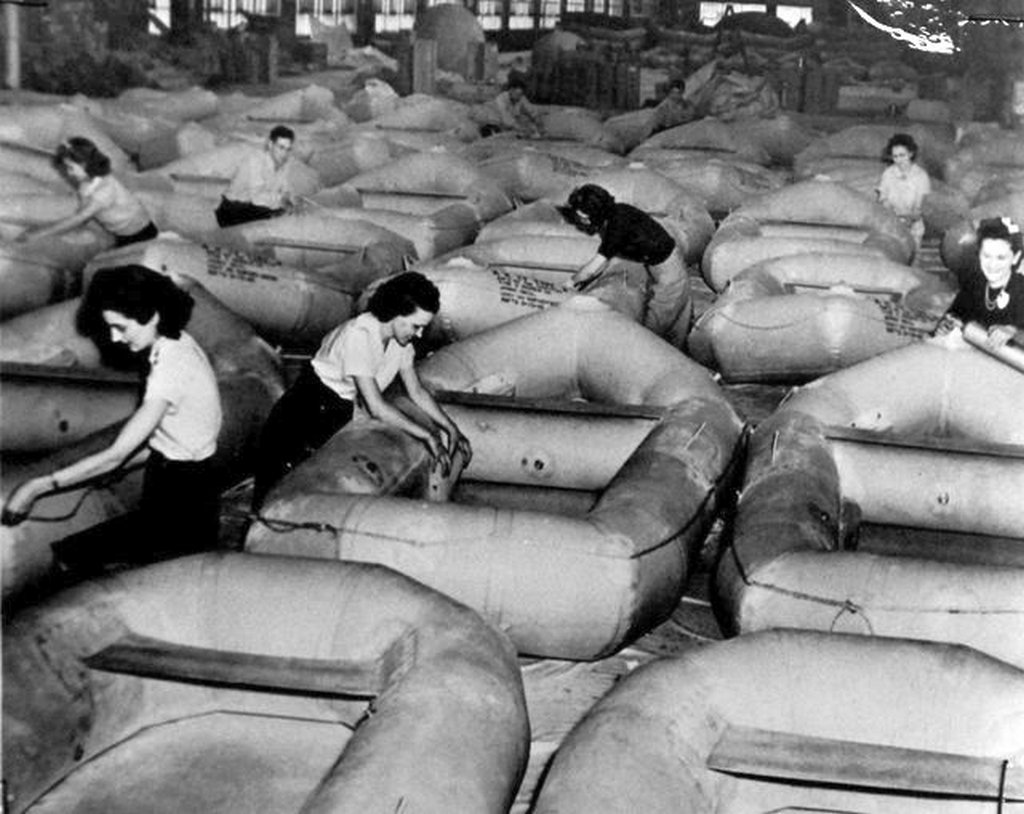 1942_life_rafts_in_mass_production_for_u_s_navy_in_the_balloon_room_of_a_u_s_goodyear_tire_and_rubber_company_plant_workers_put_finishing_touches.jpg