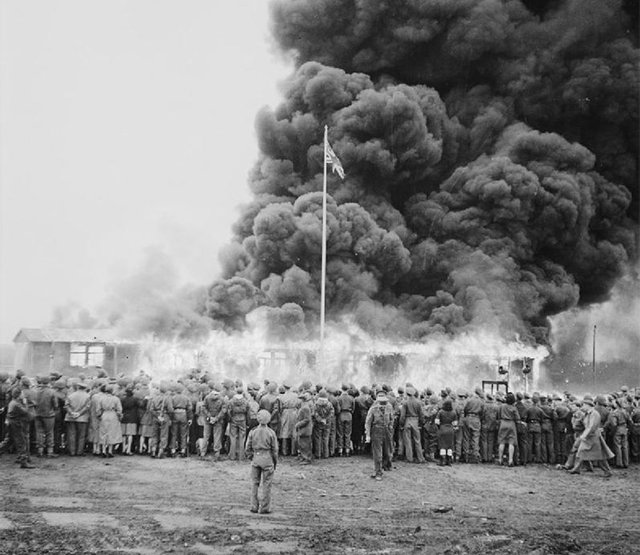 1945_allied_forces_watch_the_destruction_of_the_last_hut_at_the_bergen_belsen_concentration_camp.jpg