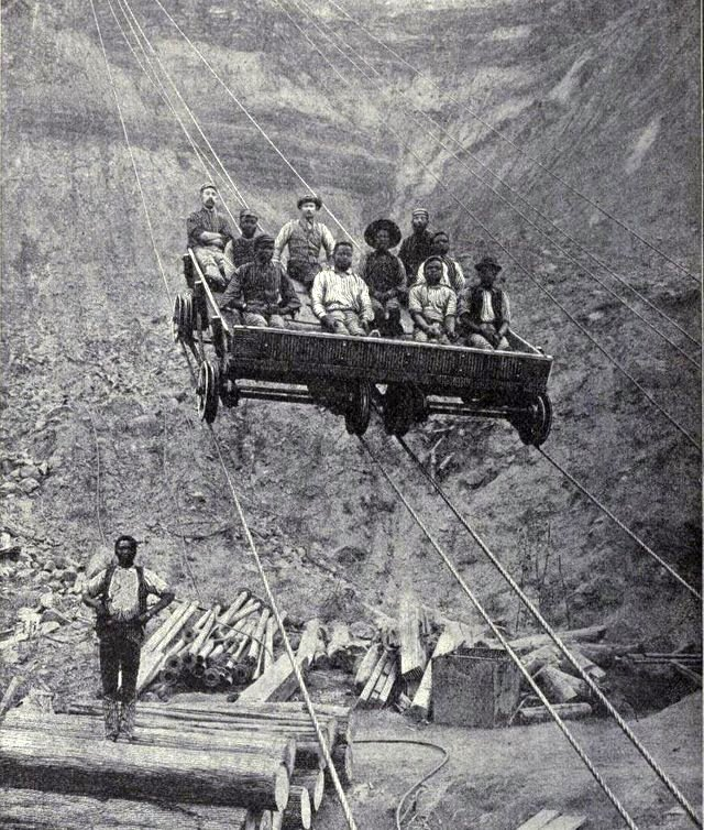 1885_miners_using_an_aerial_tram_to_descend_into_the_kimberly_diamond_mine_in_south_africa.jpg