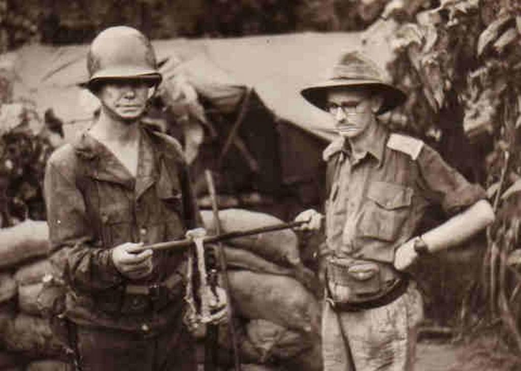 1943_papua_allied_officers_holding_the_forearm_bones_from_american_officer_who_was_mia_near_sanananda_point_and_probably_got_eaten_by_japanese_soldiers_all_of_the_flesh_had_been_stripped_from_these_bones_and_other.jpg