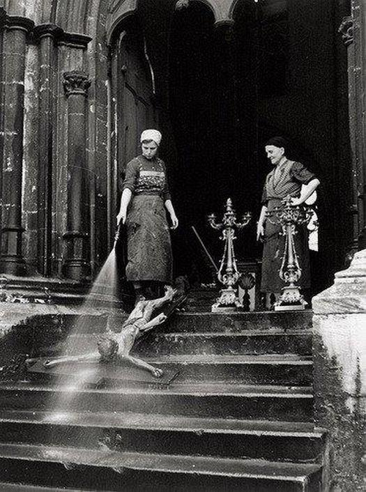 1938_cleaning_women_washing_a_crucifix_usa.jpg