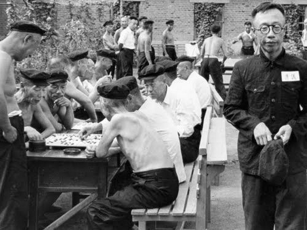 1948_aisin_gioro_puyi_far_right_the_last_emporer_of_china_undergoing_reform_through_labor_in_a_socialist_reform_camp_in_china.jpg
