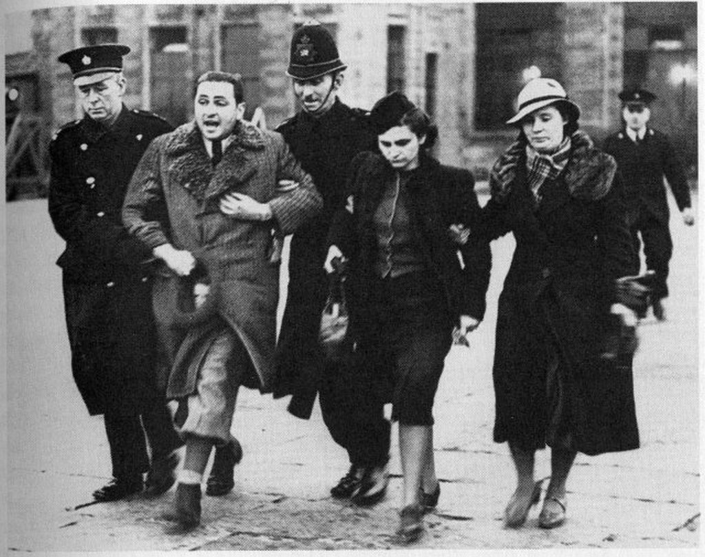 1939_jewish_refugees_from_czechoslovakia_being_deported_by_british_police_because_their_papers_weren_t_in_order_croydon_airport.jpg