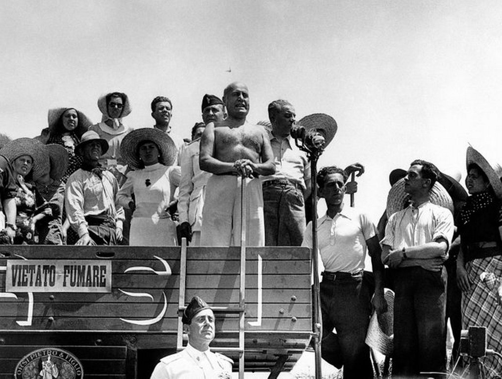 1938_benito_mussolini_stands_on_a_wheat_threshing_machine_in_aprilia_italy_to_inaugurate_the_harvest_of_1938.jpg