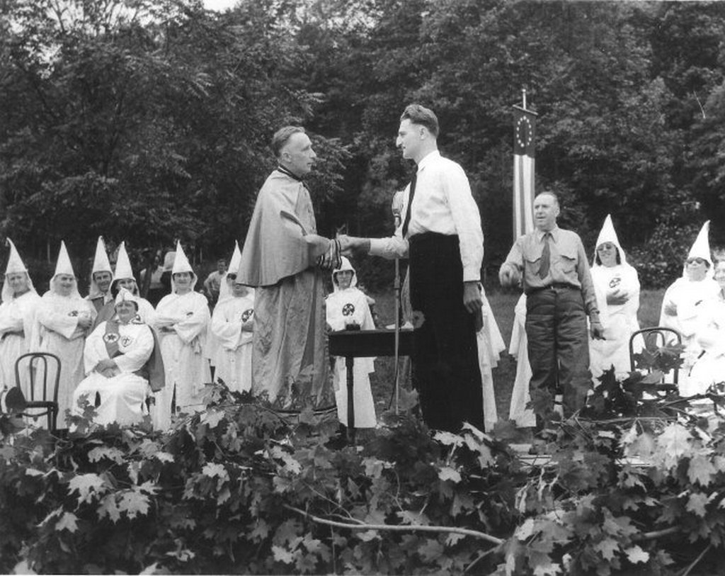 1940_the_ku_klux_klan_holds_a_rally_with_the_german_american_bund_at_the_bund_s_camp_nordlund_in_andover_new_jersey.jpg