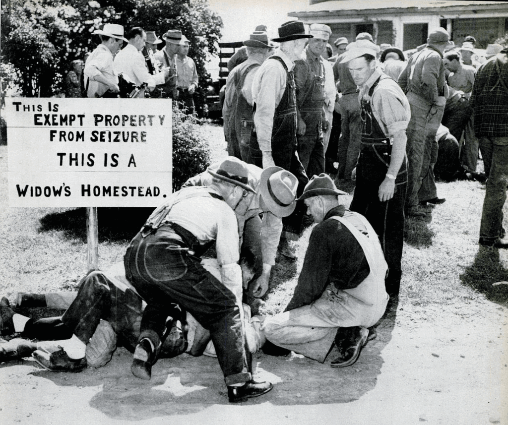 1952_farmers_take_down_the_sheriff_who_is_trying_to_evict_a_widow_from_her_farm_after_the_insurance_company_failed_to_do_so_near_lapeer_michigan_cr.png