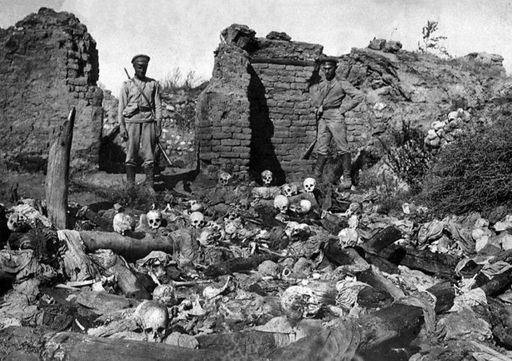1915_adana_two_turkish_soldiers_in_front_of_massacred_armenian_civilians_armenian_genocide.jpg