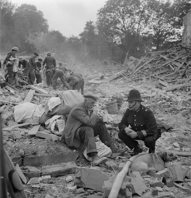 1944_a_police_officer_attempts_to_console_an_elderly_man_after_his_wife_was_killed_in_a_v1_doodlebug_flying_bomb_attack_england.jpg