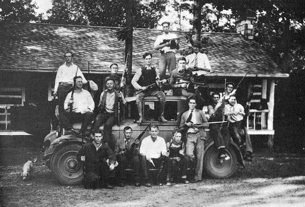 1927_southern_illinois_bootlegger_charlie_birger_center_sitting_on_car_roof_and_his_gang.jpg