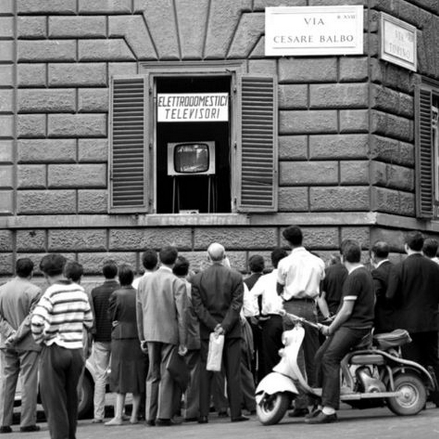 1960_people_from_the_street_stopping_by_a_tv_store_in_italy_to_watch_the_1960_olympics.png