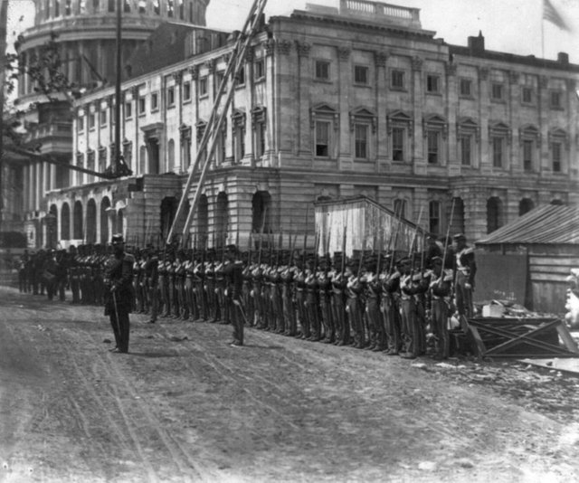 1861_may_a_few_weeks_after_the_outbreak_of_the_civil_war_united_states_union_soldiers_begin_guarding_washington_d_c_from_rebel_attacks_as_construction_of_the_capitol_building_continues_on_around_them.jpg