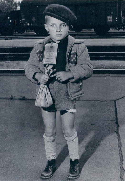 1957_unaccompanied_hungarian_boy_carrying_only_a_small_paper_bag_of_food_awaiting_travel_to_australia_after_the_collapse_of_the_1956_revolution.jpg