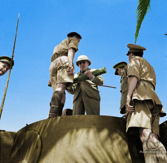 1943_winston_churchill_atop_a_german_tiger_mark_vi_tank_tunis.png