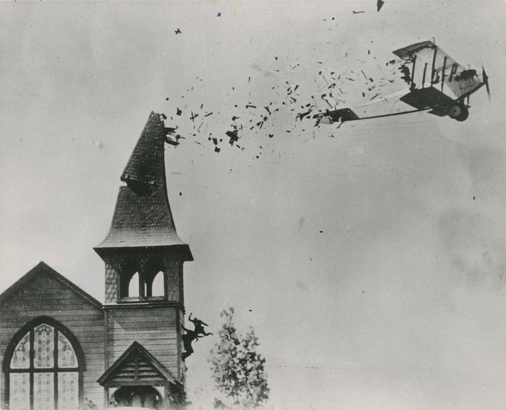 1920_pilot_omar_lockyear_flying_his_plane_through_a_breakaway_church_steeple_while_filming_the_lost_silent_movie_the_skywayman.jpg