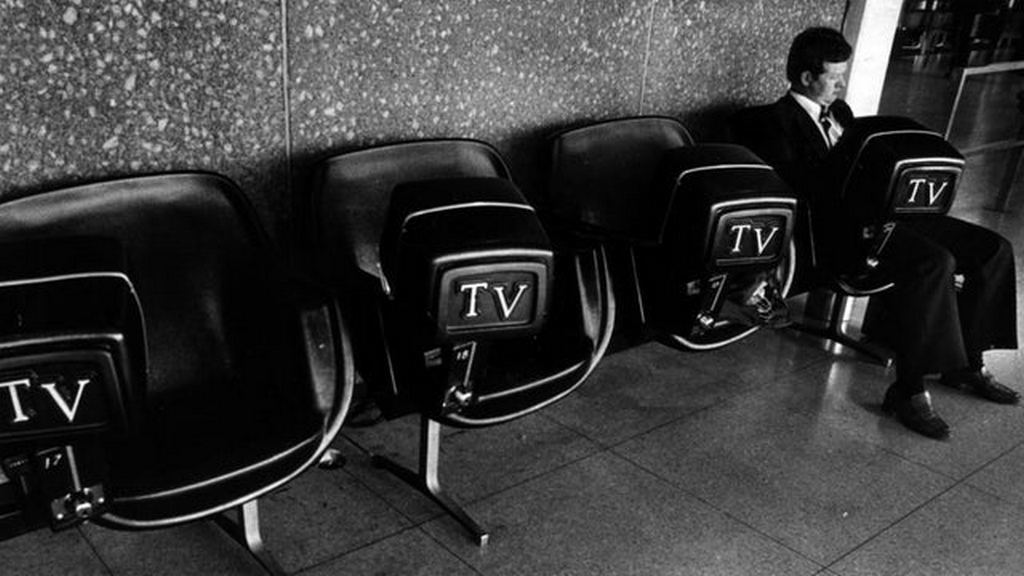 1980_a_man_rests_at_o_hare_international_airport.jpg