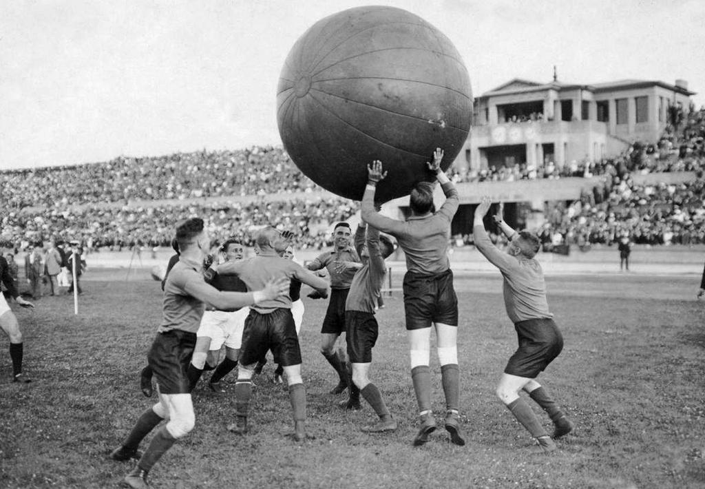 1924_two_teams_play_a_game_of_pushball_in_a_packed_stadium_berlin_germany.jpg
