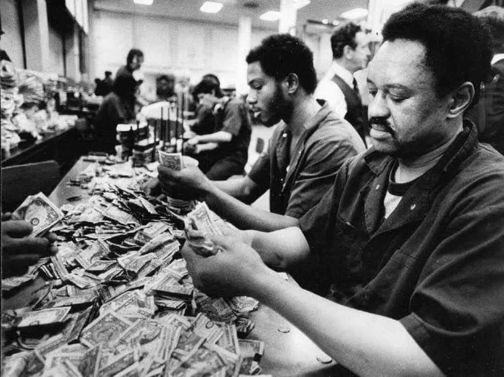 1977_chicago_transit_authority_cta_employees_counting_fare_intake_by_hand.jpg
