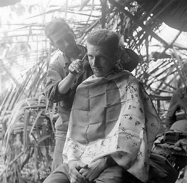 1943_australian_soldiers_use_a_captured_japanese_flag_as_a_barbers_cape_in_new_guinea.jpg