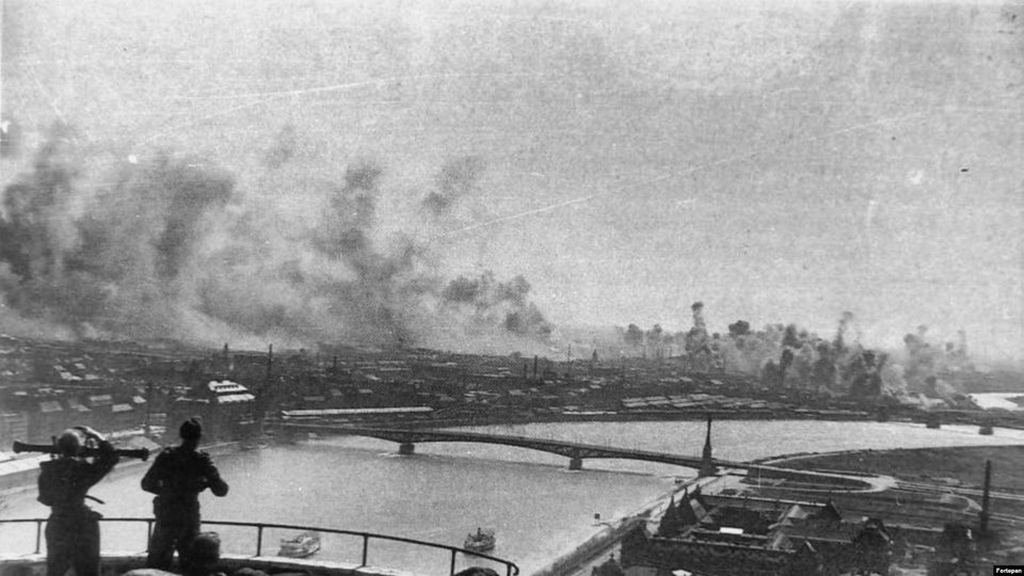 1944_hungarian_soldiers_with_a_range_finder_watch_from_gellert_hill_as_bombs_from_an_american_air_raid_pummel_nazi-occupied_budapest.jpg