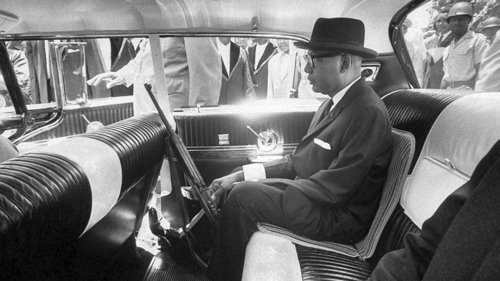1963_haitian_dictator_fran_ois_papa_doc_duvalier_carrying_a_gun_as_he_rides_through_port_au_prince_streets.jpg