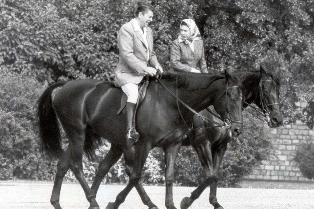 1982_candid_photo_of_president_ronald_reagan_and_hrh_queen_elizabeth_ii_riding_horses_around_home_park_in_windsor_on_visit_to_windsor_castle.jpg