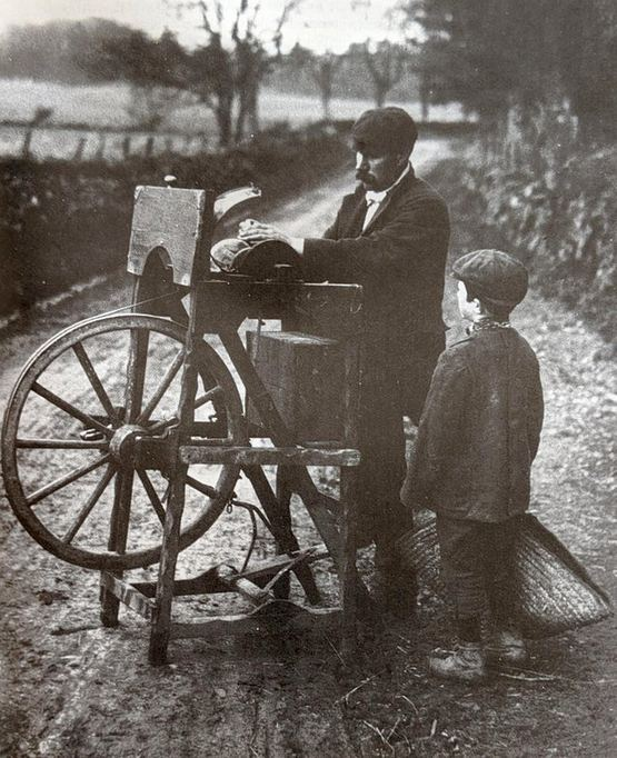 1904_tinker_with_treadle-wheel_sharpening_a_knife.jpg