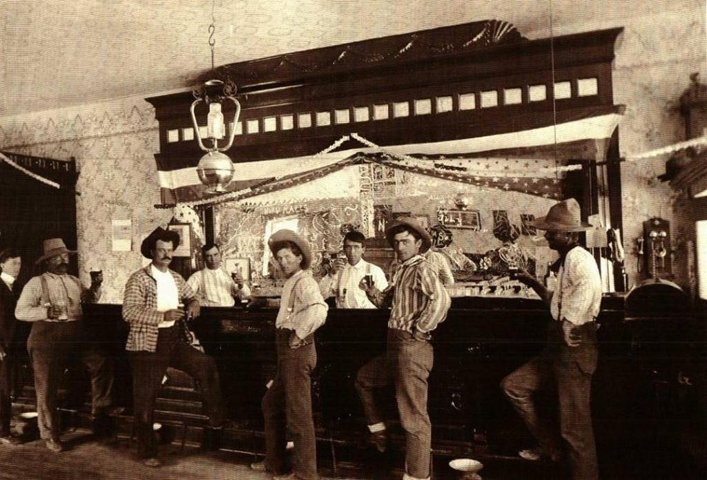 1902_cowboys_drinking_at_an_unidentified_saloon_in_dallas_texas.jpg