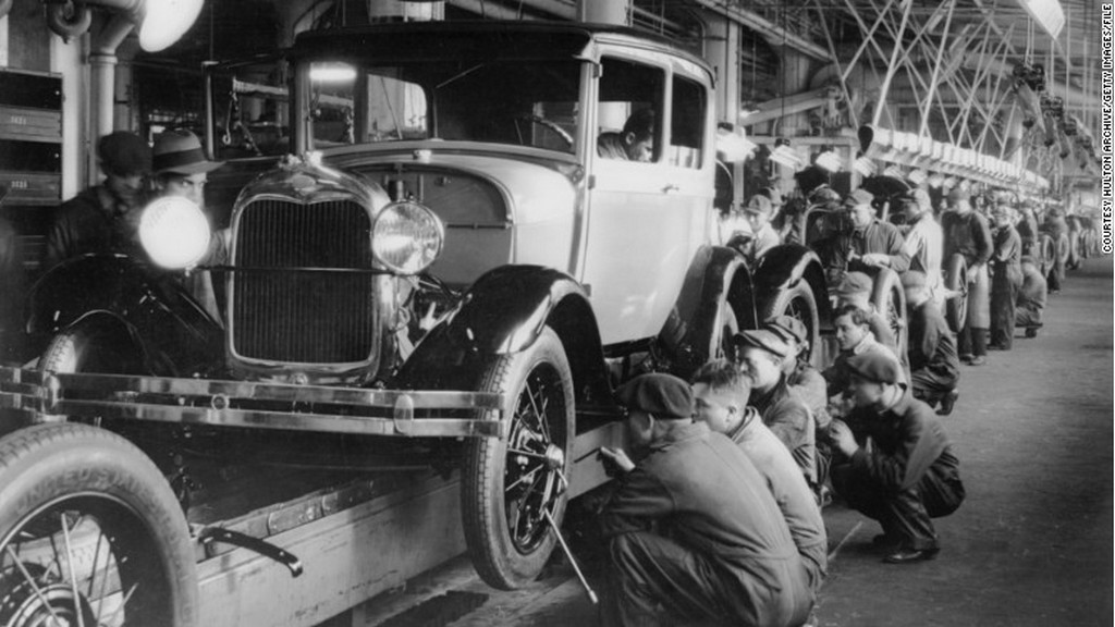 1927_ford_workers_work_on_the_new_model_a_assembly_line.jpg