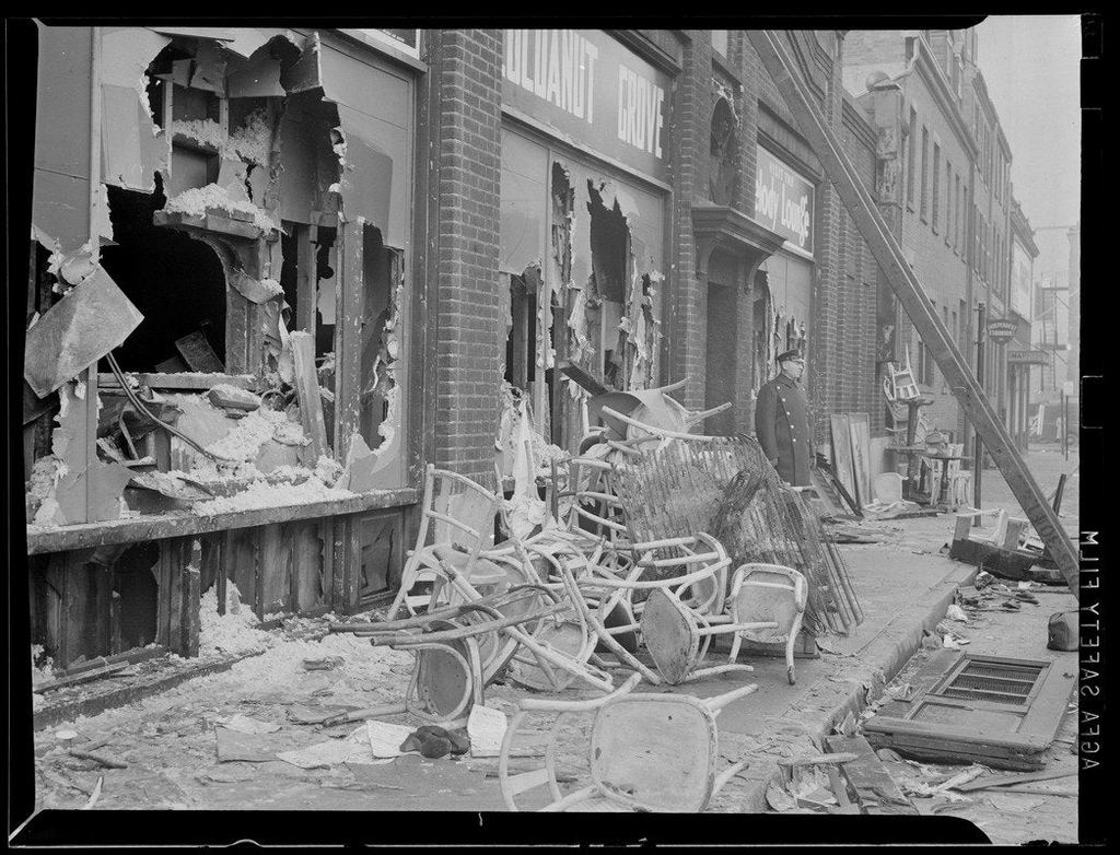 1942_november_29_chairs_and_wreckage_outside_the_cocoanut_grove_nightclub_in_boston_scene_of_the_deadliest_nightclub_fire_in_us_history.jpg