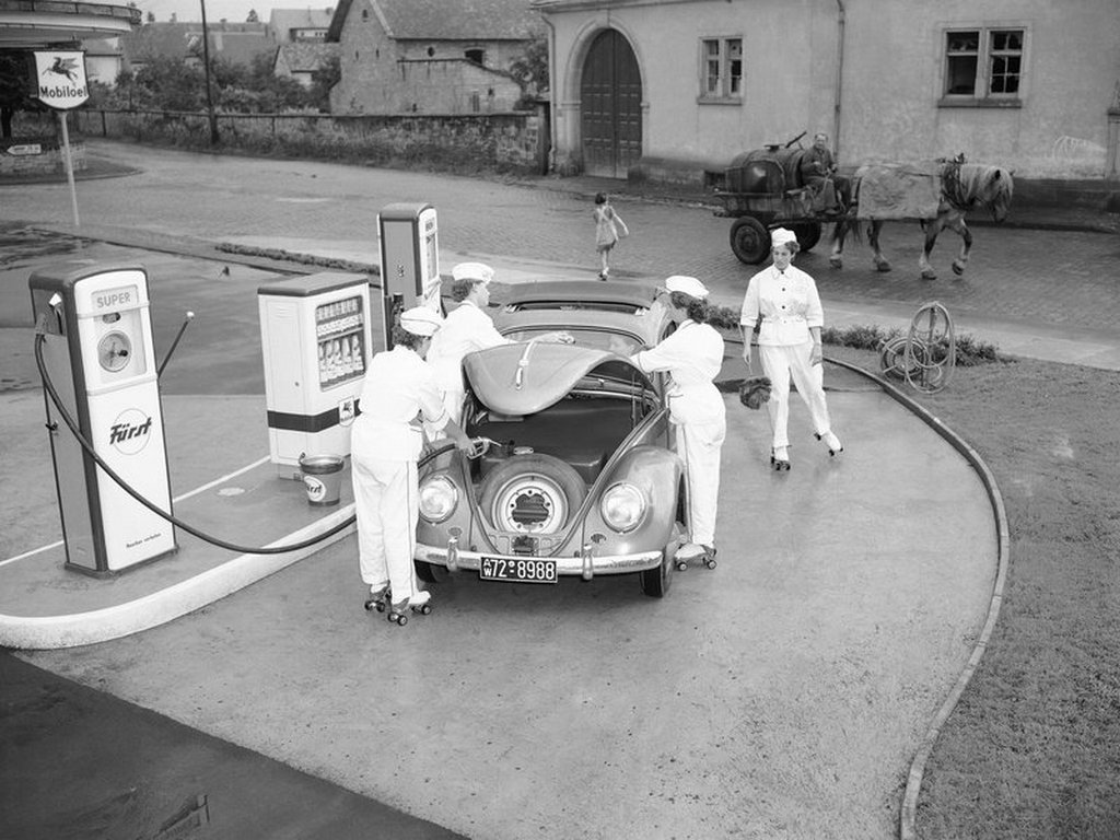 1954_employees_on_roller-skates_tend_to_a_volkswagen_at_a_gas_station_in_deidesheim_germany.jpg