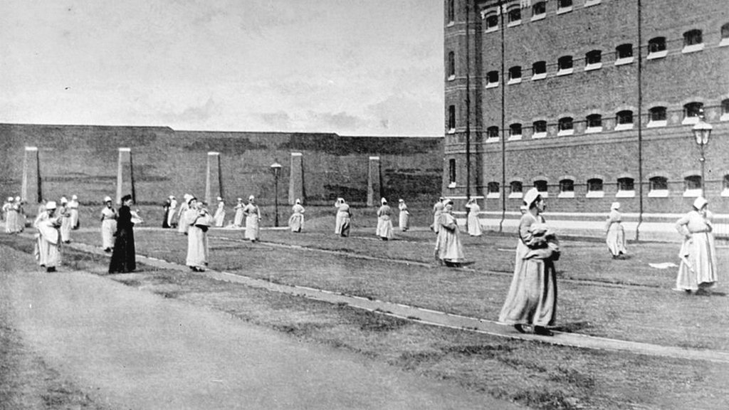 1890_mothers_walking_with_their_children_in_the_exercise_yard_of_wormwood_scrubs_prison_in_london.jpg