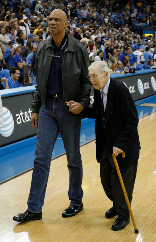 2007_former_ucla_player_kareem_abdul-jabbar_assists_former_ucla_basketball_coach_97_years_old_john_wooden_off_the_court_after_celebrating_the_40th_anniversary_of_1967_national_championship_team.jpg