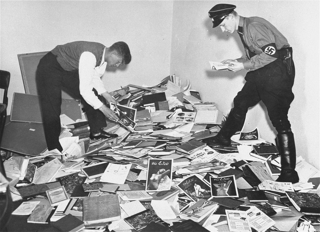 1933_nazis_examine_books_confiscated_from_the_institute_for_sexual_research_before_sending_them_off_to_be_burned_berlin.jpg