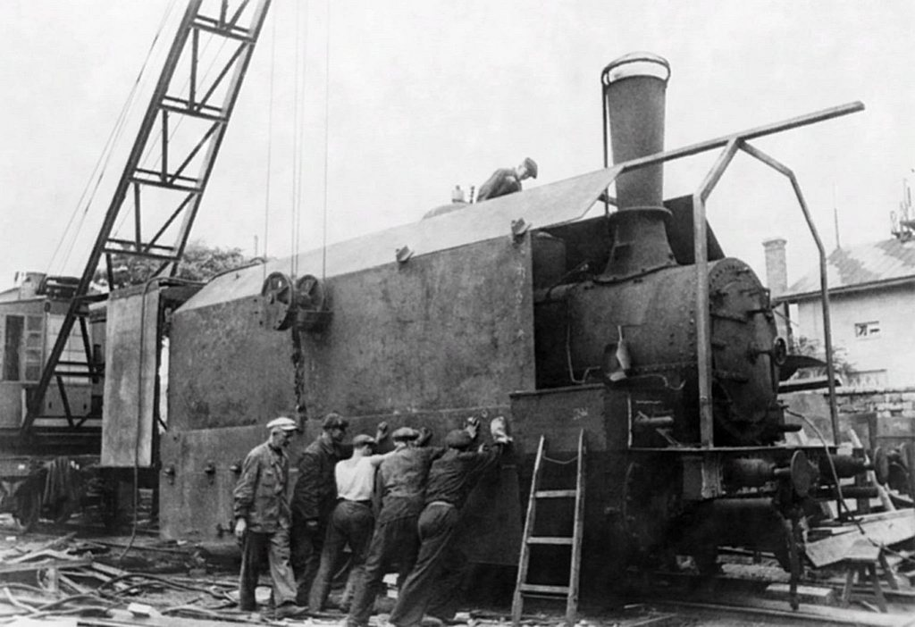 1941_the_construction_of_the_armored_train_of_the_red_army_at_the_plant_of_the_january_uprising_in_odessa_ukraine_ussr_soviet_workers_assemble_sheets_of_armor_steel_on_a_steam_locomotive.jpg