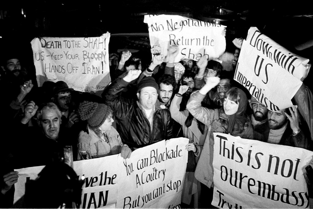 1979_december_americans_who_support_iran_s_position_in_the_hostage_crisis_join_with_iranians_in_anti-american_demonstrations_outside_the_u_s_embassy_in_tehran.jpeg