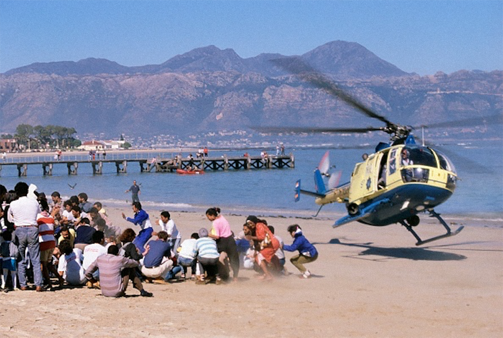 1989_south_african_police_disperse_an_anti-apartheid_protest_with_a_helicopter_cape_town.png